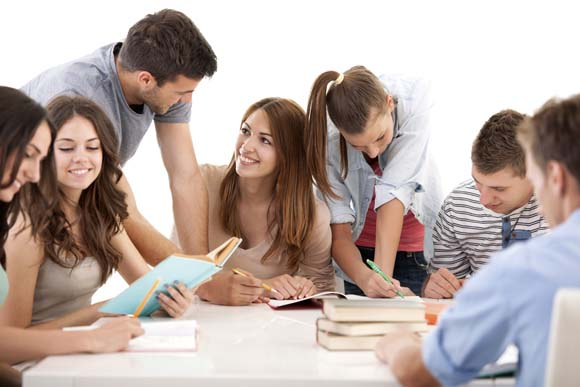Large group of smiling students studying together. Isolated on white.  [url=http://www.istockphoto.com/search/lightbox/9786738][img]http://dl.dropbox.com/u/40117171/group.jpg[/img][/url]