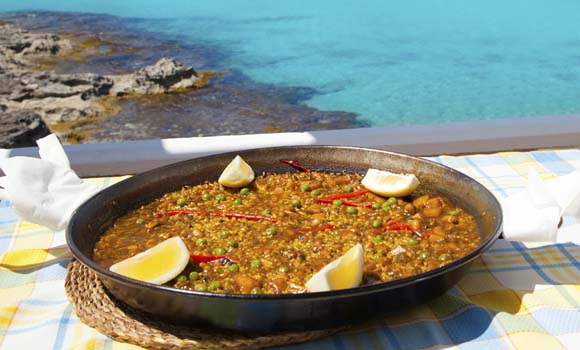 Paella mediterranean rice food by the Balearic Formentera island beach